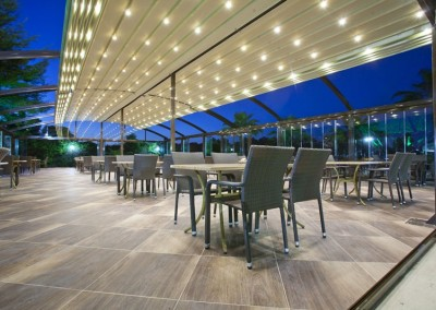 Arched Retractable Roofing Over Dining Area Night