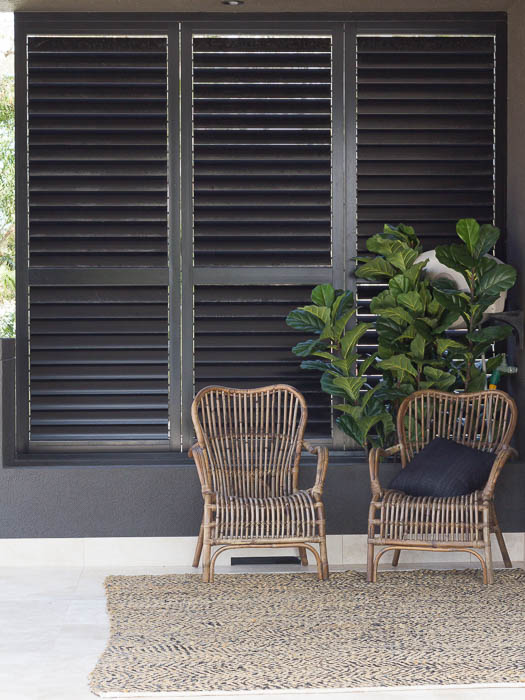 Dark Brown Plantation Shutters in Sitting Area - closed