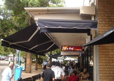 Folding Arm Awning Over Cafe Eatery