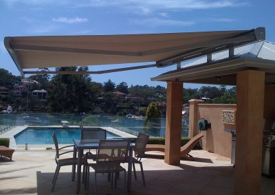 Folding Arm Awning Over Poolside Table