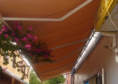 Folding-Arm-Awning-Over-Alley