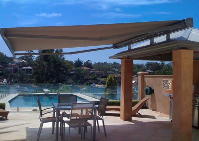 Folding-Arm-Awning-Over-Poolside-Table