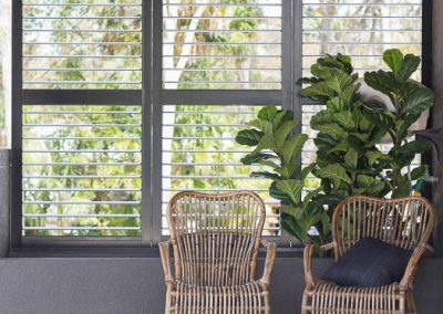 Dark Brown Plantation Shutters in Sitting Area - open