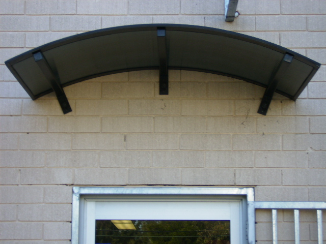 polycarbonate and aluminium awnings sydney on feature brick wall